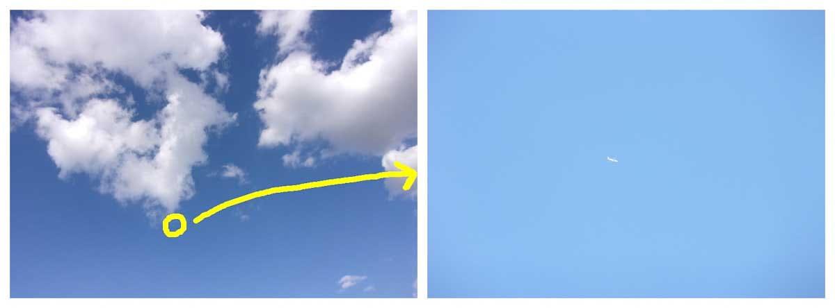 青空の中飛んでいる飛行機